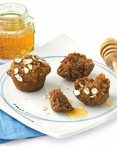 SWEET SNACKS < 200 Calories _ Oat Bran-Applesauce Mini Muffins | Dates and applesauce -- full of fiber, vitamins, and natural sugars -- create a complex caramel flavor when combined with honey. Makes 24 muffins (50 calories each).