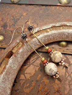 With 8mm round Jasper stone, copper beads and glass seed beads. Earrings are 2 inches total in length, these are small very lightweight and simple.  Comes beautifully gift boxed. Lead and nickel free All of my jewelry is made by me and handmade and with care and love. Thank you for shopping hand made and Thanks for visiting! Let's visit some more on Facebook, I'd love to be your friend! www.facebook.com/pages/McKee-Jewelry-Designs/247578775324008