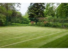 A private backyard grass tennis court!  Is this Heaven?