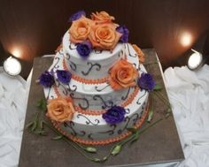 Purple and orange wedding cake- our wedding colors!