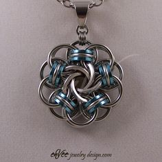 """Vortex"" medallion... Stainless steel and anodized aluminum, round and square wire, 1 3/8"" across, 16.3 grams."
