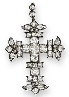 An early 19th century diamond cross pendant, c.1820 The cross fleury set throughout with cushion-shaped diamonds, mounted in silver and gold,