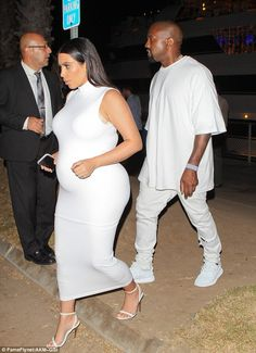 Casual cool: Kanye wore a baggy white top with matching trousers and all-white versions of...