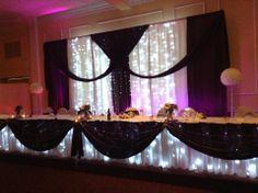 Eggplant and White wedding decor at Bingeman's Convention Centre in Kitchener
