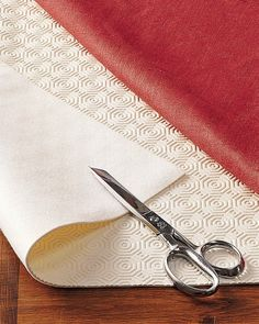 The best hotels and restaurants place pads under their tablecloths. A pad provides better drape for the cloth, muffles noise, and protects the tabletop from heat, moisture and scratches.