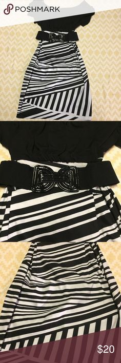 Alyx limited dress Cute black and white dress with original belt. Size 12 with measurements in the photos. Tight fitting dress. No flaws Alyx Dresses