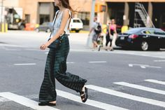 This Year, NYFW Street Style Is All About Minimalism #refinery29  http://www.refinery29.com/2016/09/120553/nyfw-spring-2017-best-street-style-outfits#slide-1  Pajama pants and flat sandals. Points for practicality....