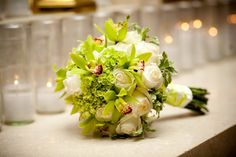 green orchids with white roses bouquet