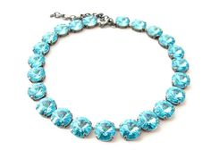 Big stone Swarovski light turquoise crystal rivoli rhinestones set in antiqued silver hardware, in a beautiful choker style necklace. Gorgeous