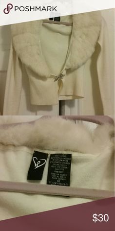 ??White winter cardigan with fur collar?? This doesn't say what kind of fur this is but this doesn't feel fake. Please let me know if this isnt to posh standards and I will remove it. Needs a little love. It is truly a beautiful winter piece. Will be freshly dry cleaned when bought. It lost two rhinestones in the clasp and  needs to be re-fastened. I still think it is beautiful though. I probably bought this for 60 dollars or more. I am worried this is the fur of an endangered animal and I…