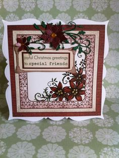 Festive Christmas papers, Spellbinders poinsettia, XCut flower punch, Cheery Lynn Holly Flourish. Go Kreate square frilly frame #7 base card.
