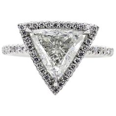 View this item and discover similar for sale at - A ring for a Princess! SUPER Elegant and UNIQUE Micro Pave Platinum Diamond Halo Trillion Diamond ring from our Estate Collection. Trillion Engagement Ring, Engagement Ring Shapes, Platinum Engagement Rings, Platinum Ring, Diamond Wedding Rings, Champagne Sapphire Rings, Diamond Tops, Thing 1, White Gold Rings