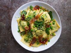 Fill fresh ravioli with a combination of peas, mint, and ricotta, then dress with lemon and prosciutto for a springlike take on the dish.