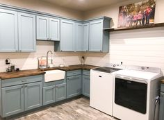 Large, farmhouse laundry room. Shiplap, blue cabinets, butcher block countertops