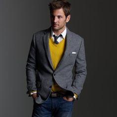 grey wool blazer / white shirt / black tie / golden yellow v-neck sweater / white pocket square / black belt with square peg / blue stone-washed jeans