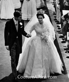 Norman Hartnell designed this silk organza wedding gown for Princess Margaret.  She is also wearing the dramatic Poltimore tiara, which was sold by her children after her death.  The wedding took place on May 6, 1960 and it was the first Royal Wedding broadcast on television worldwide.