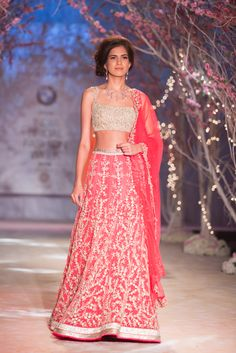 Pink Indian wedding lehenga with gold blouse by Jyotsna Tiwari. More here: http://www.indianweddingsite.com/bmw-india-bridal-fashion-week-ibfw-2014-jyotsna-tiwari/