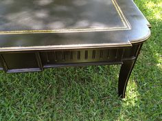 """""""AFTER""""- A brown Heckman coffee table was painted with Annie Sloan Chalk Paint in """"Primer Red"""" and allowed to dry, followed by Rust-oleum black satin spray paint. Accent areas were then pinstriped """"Glorious Gold"""" with a liner brush and prominent  table edges were lightly distressed.  Finally, all of the painted areas were sprayed with Zinsser Bull's Eye Shellac Traditional Finish and Sealer to provide an extra layer of protection."""