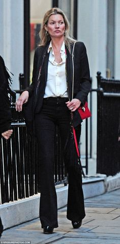 Working it: Kate Moss rocks flared jeans during a shopping trip to Mayfair's trendy Mount ...
