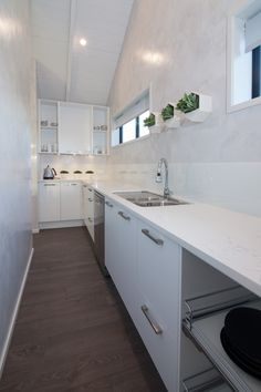 A closer look at the scullery which runs along behind the kitchen with entry at both ends!
