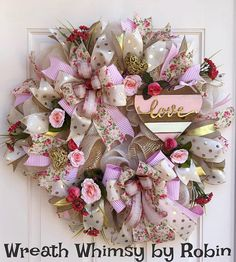 Romantic Valentines Day Wreath in Pink, Cream and Gold. Add a bit of romance to your entryway with this sweet Valentines Wreath! This wreath is constructed with an ivory burlap mesh that is then layered with rolls of soft gold mesh. A soft pink wood heart is embellished with