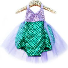 Beautiful romper part of our Merbabe Sparkle Romper collection. Sequin color might vary slightly. Sequin Top: Lavender Bottom Fabric: Emerald with Lavender Tutu