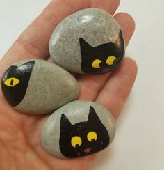 Cute and Creative Rock Painting Ideas cats.  tag: rock painting ideas easy, rock painting ideas fish, rock painting ideas animals, rock painting ideas beach, rock painted fun face. #rockpaintingideas #art #creativeideas #forkids #craft #DIY #rockart #artstones