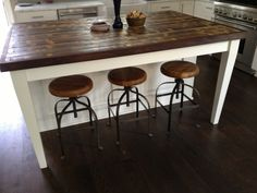 Furniture. Housewifely Reclaimed Wood Kitchen Island Designs. Amazing White And Brown Color Scheme Reclaimed Wood Kitchen Island With Simple Three Stools On The Dark Wood Flooring That Have Round Shaped Seat Space Complete With The Black Metal Materials Legs. .