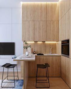 Apostar no contraste de materiais é sempre uma boa pedida para valorizar volumes! Neste projeto de Andrey Karasev, a compacta cozinha marcou presença no espaço com a madeira instalada do piso ao teto.