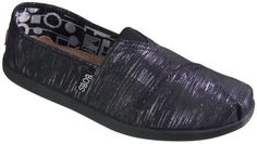 Women's Skechers, Bobs World Shoe  The original slip on Bobs shoe with a fun twist  Soft fabric upper with metallic stripe designs  Tucked toe pleat front with diagonal stitched seam detail at vamp  Front elastic stretch panel for easy fit  Soft fabric shoe lining  cushioned leather topped comfort insole with pillow arch cushion for added support  shock absorbing low profile midsole and flexible r ...