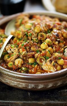 Spanish (Mediterranean) braised chickpeas with tuna and olives~ Everything sounds amazing except the canned tuna.  Maybe if it was fresh tuna, but canned sounds like it would screw up a perfectly good dish.