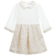Unique and beautiful baby girls dress by Patachou with an ivory georgette bodice combined with a synthetic fur collar, cuffs and skirt highlighted with gold paint. It has three quarter length sheer sleeves, is fully lined in cotton for comfort and has a concealed zip fastening at the back.