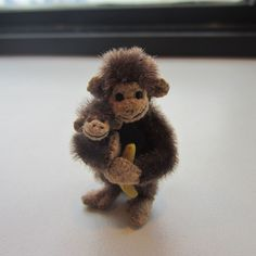 "Mary Bures, A Grand Scale, IGMA fellow - ""Monkey Love"" , larger monkey is 2"" tall, made in $1999; sold on ebay for $159.99"
