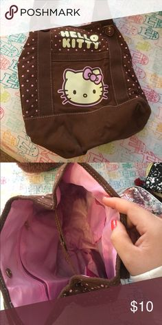 Hello Kitty Purse Medium sized bag! Can be made a little smaller with straps that are buttoned as shown in picture Comes from a smoke free home. Bought from the Hello Kitty Store! Bags Shoulder Bags