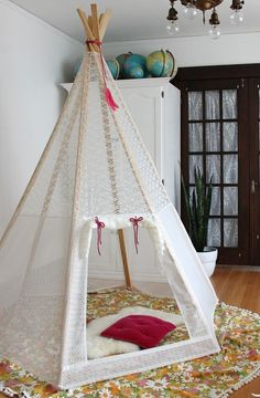 I love this see through teepee. I would like to try and make a mini doll teepee so the children can see inside.