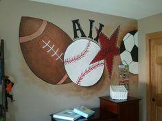 Sports mural in little boys room.