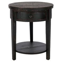 "Display a bouquet of fresh blooms or cherished family photos atop this chic end table, showcasing 1 drawer and a bottom display shelf for ample storage.    Product: End tableConstruction Material: Tung, birch and fir woodColor: Weathered black and cabernetFeatures: One drawerOpen bottom shelfDimensions: 25"" H x 20"" DiameterAssembly: Simple assembly required"