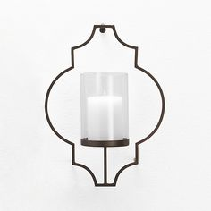 like this because it mirrors the shape in the curtains. Rosaline Metal Wall Candl e Holder