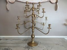 This stunning and large candelabra is perfect for any celebration. Good sturdy condition. Wear to the brass finish gives it character and charm. Really a show stopper.  Measure: 24 1/2 h x 22 wide  This will be disassembled for shipping. Some of the pieces may need to be tightened by hand upon delivery, as it has many pieces that screw on and may become loose during shipping:) Much more at vintageshoppingspree.etsy.com