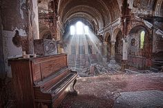 One of Glenn Petranek photographs is that of St. Joseph Byzantine Church in Cleveland, which sits crumbling and abandoned. The piano remains illuminated by strong morning light. (Photo courtesy of Glenn Petranek) Abandoned Churches, Abandoned Places, Playhouse Square, Cleveland Art, Square Chandelier, Forgotten Treasures, Sun Photo, St Joseph, Morning Light
