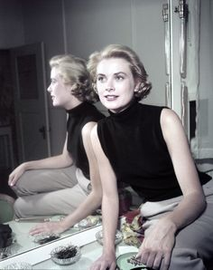 graceandfamily:  Grace Kelly (1929 - 1982) wearing a black sleeveless top, 1954. Photo by Gene Lester.    dosesofgrace:  sdfghjkloiyrcvbnmlç