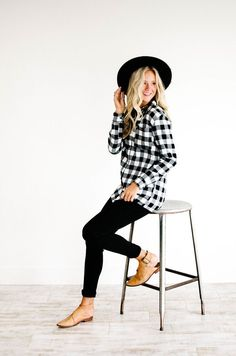 """Black + White Checkered Top Button Down Front w/ Collar Front Chest Pocket Long Sleeve w/ Buttoned Cuffs Tunic Length View Size Chart Blonde Model is 5'9"""" + Wearing a Small Brunette Model is 5'5"""" + Wearing a Large"""