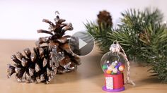 Turn a small clear ornament into an adorable gumball machine that will add sweetness to your holiday tree.