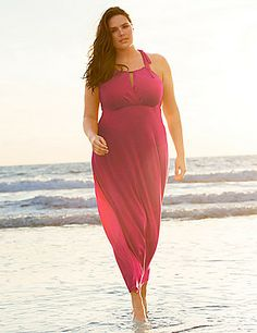 In a soft knit and easy-wearing long length, our versatile maxi dress is essential wear for the sunny days ahead! The perfect pick for everything from lazy-day lounging at home, to hitting the beach, to hanging with the girls, this flattering maxi accentuates the positives with a shoulder-baring halter top, surplice neckline and empire waist. Pull-on style with tied halter closure. lanebryant.com
