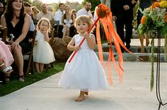 adorable flower girl with streamers