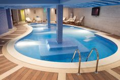 basement pool?  yes please.  I love this retro shape....  but, where do you swim laps?