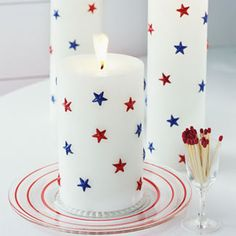 Star Candles by goodhousekeeping: Simply made with star stickers for kid friendly fun.