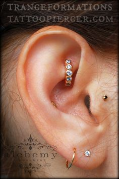 Rook piercing with beautiful rose gold seam ring with 3 diamonds