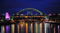 Giant Olympic Rings revealed in Newcastle and Gateshead  A set of giant Olympic Rings has been unveiled in Newcastle and Gateshead, coinciding with the Olympic Flame's journey in the North East of England.     Installed on the iconic Tyne Bridge, the Rings are approximately 25m wide by 12m high. Day 31 - Olympic Torch Relay