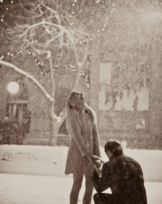 Cute proposal picture.  Love the snow and twinkly lights